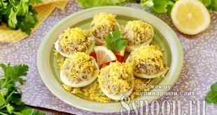 Яйца, фаршированные шпротами и сыром фото